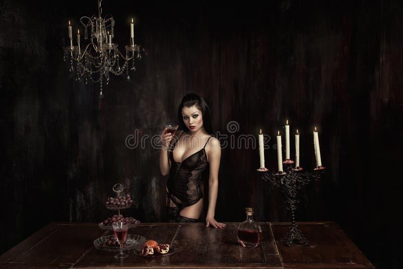 Девушка с стеклом вина стоковая фотография rf
