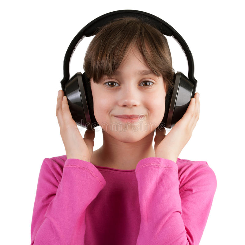 Девушка слушая к музыке на наушниках стоковое фото rf