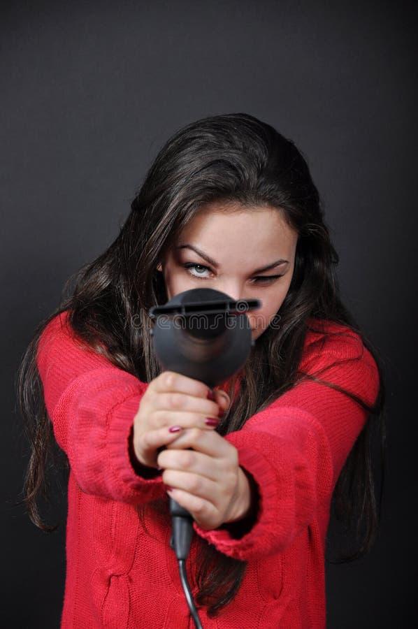Девушка с феном для волос стоковое фото rf