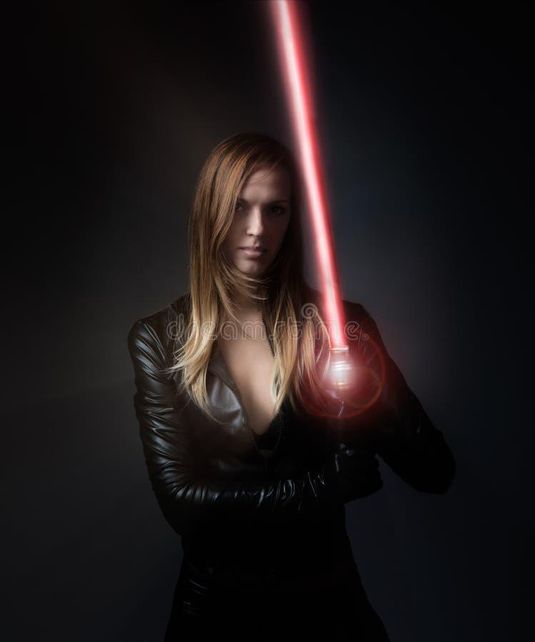 Девушка с шпагой лазера стоковое фото