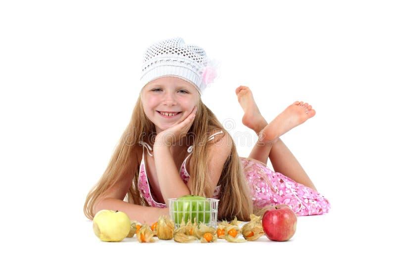 Девушка с яблоком стоковые изображения