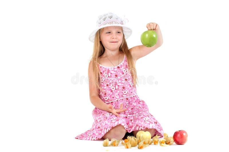 Девушка с яблоком стоковое фото rf