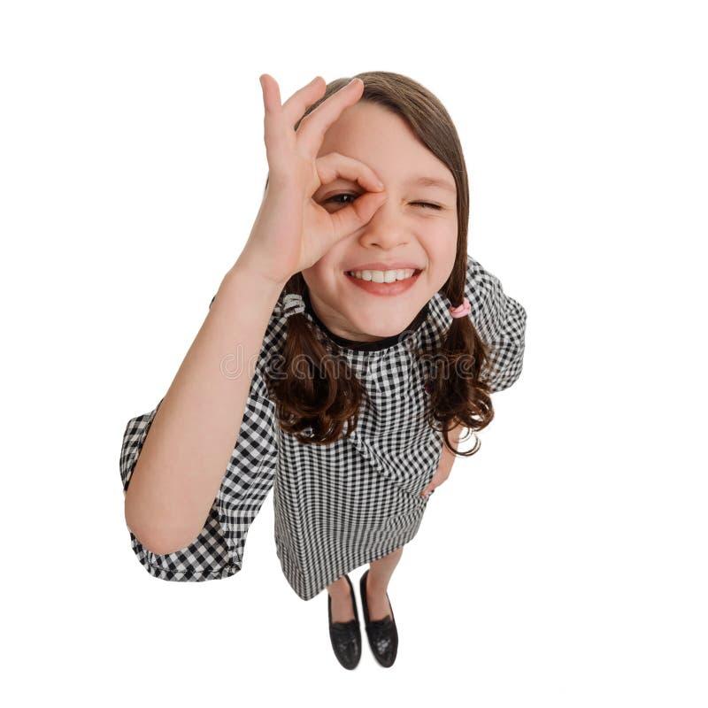 Девушка с alright знаком руки стоковое фото rf