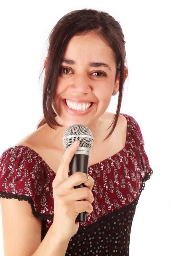 Девушка с mic в белизне стоковое фото