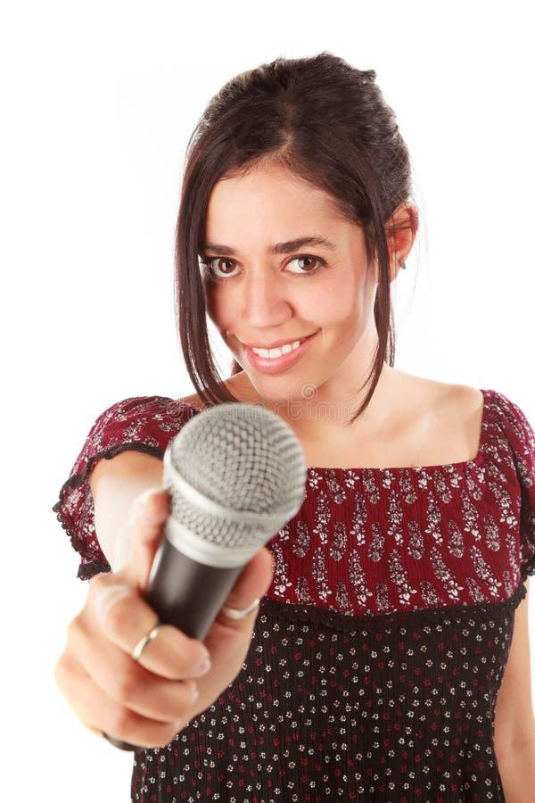Девушка с mic в белизне стоковое изображение rf