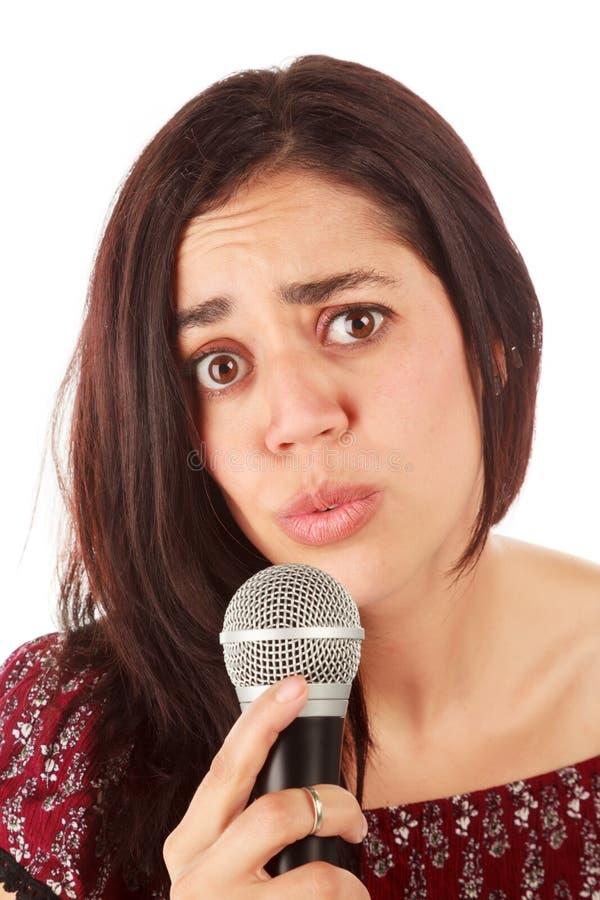 Девушка с mic в белизне стоковое фото rf