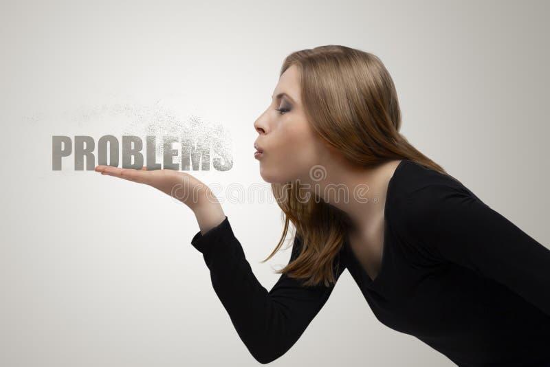 Девушка дует прочь проблемы стоковая фотография rf
