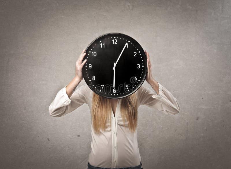 Девушка часов стоковая фотография
