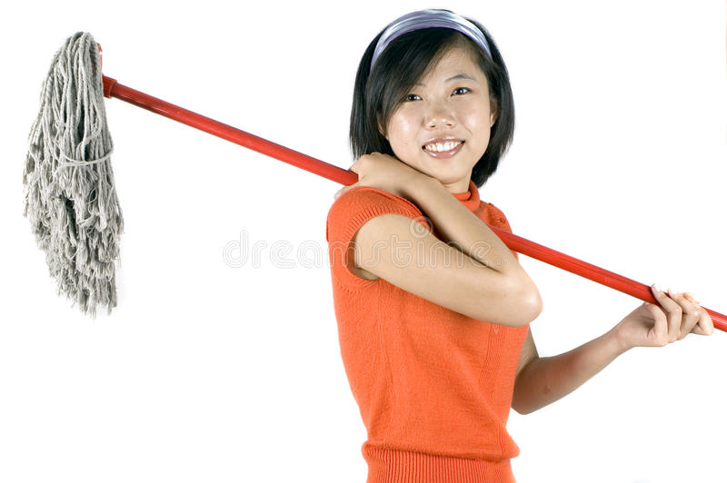 девушка чистки счастливая стоковое фото rf