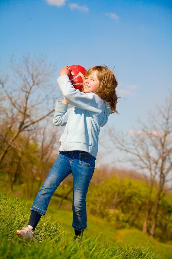 девушка шарика немногая довольно стоковое фото