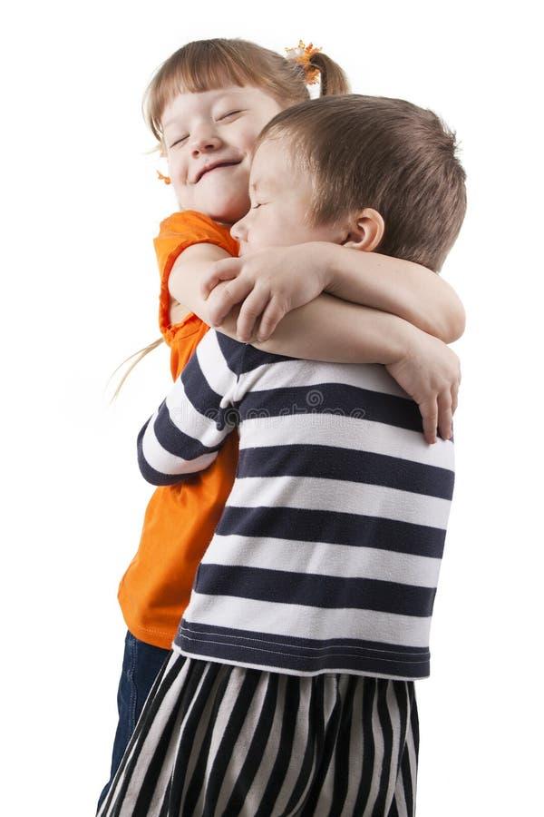 девушка embrace мальчика немногая стоковое фото rf
