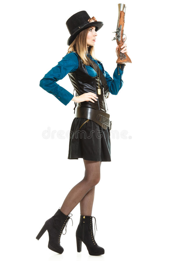 Девушка Steampunk с винтовкой стоковое фото rf