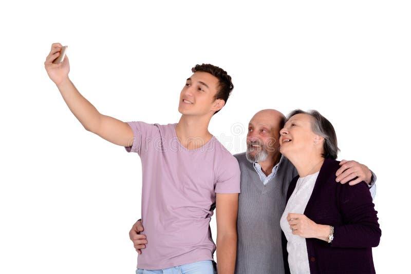 Деды и их внук принимая selfie стоковое изображение rf
