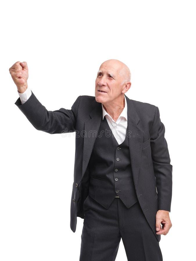 Дед показывая кулак в сторону на белизне изолировал предпосылку стоковые фотографии rf