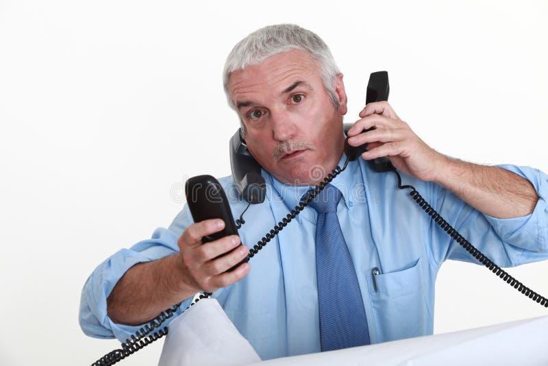 Действительно занятый бизнесмен. стоковое изображение rf