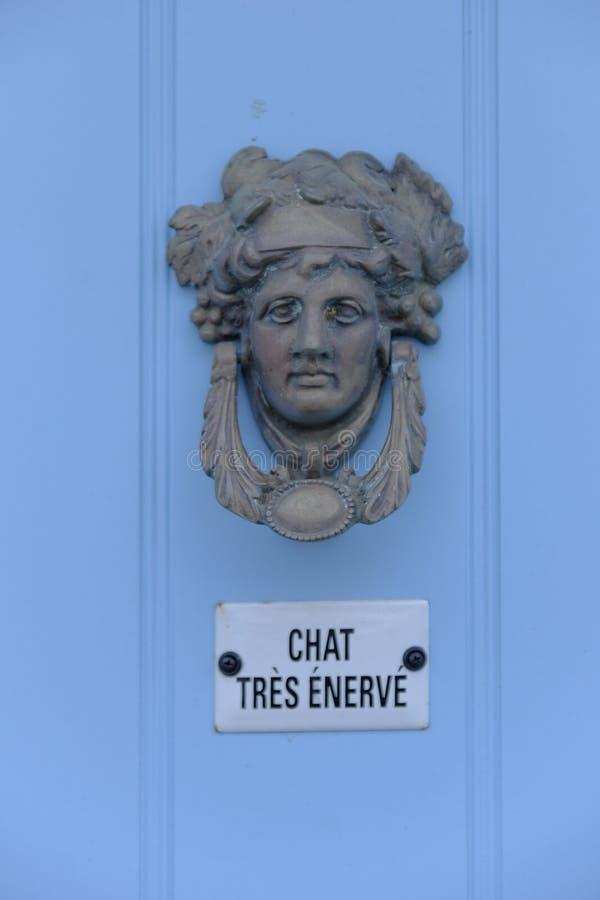 Декоративный греческий knocker двери стоковые изображения rf