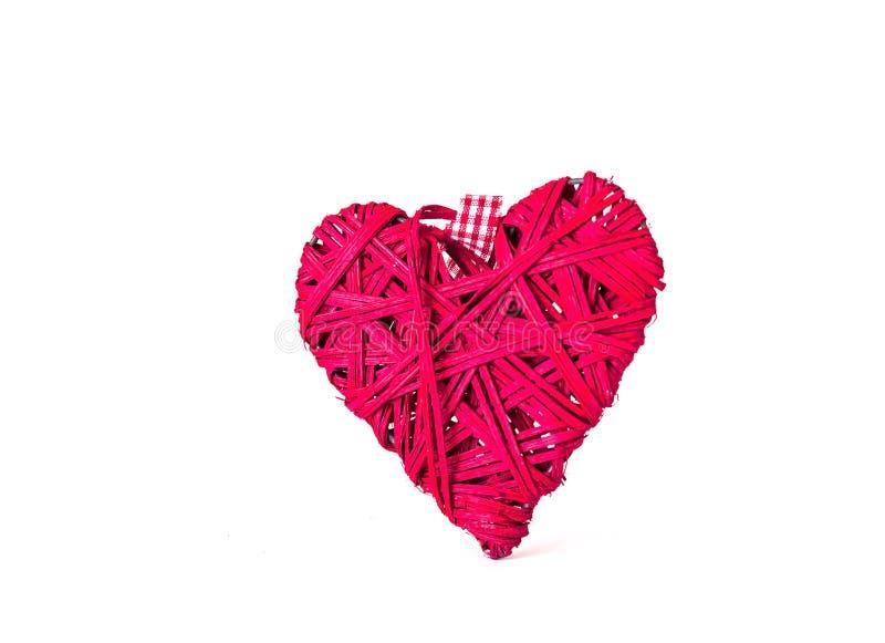 декор праздничный Красные сердце и confetti на белой изолированной предпосылке стоковые фото