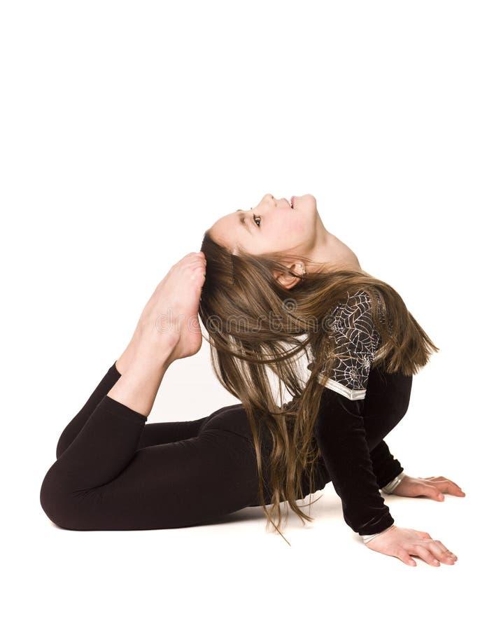 делать детенышей гимнастики девушки стоковое изображение rf
