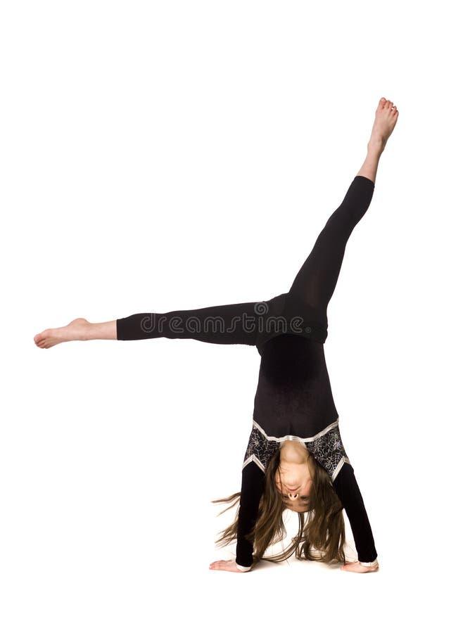 делать детенышей гимнастики девушки стоковая фотография