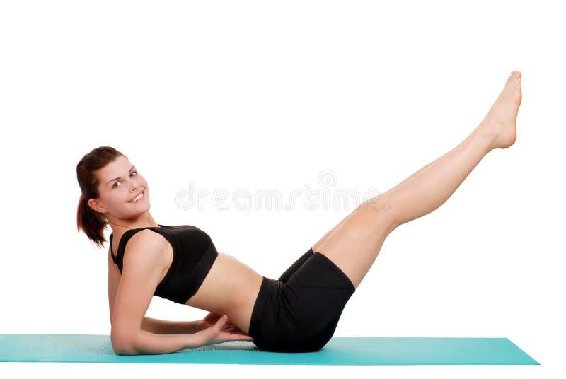 делать детенышей женщины подъема ноги стоковое изображение rf
