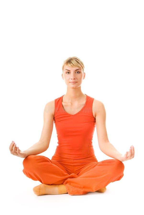 делать йогу женщины тренировки стоковое изображение rf