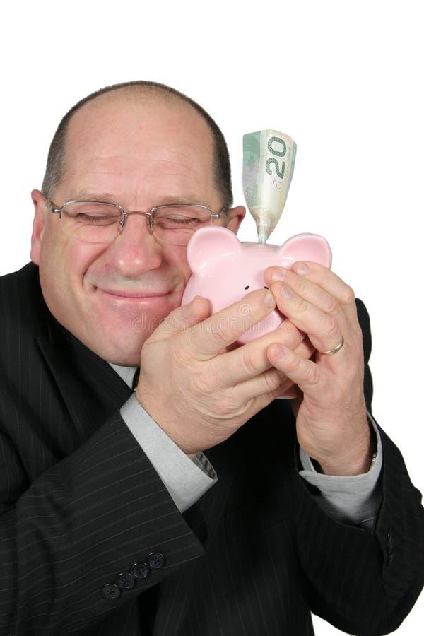 дело банка обнимая человека piggy стоковые изображения rf