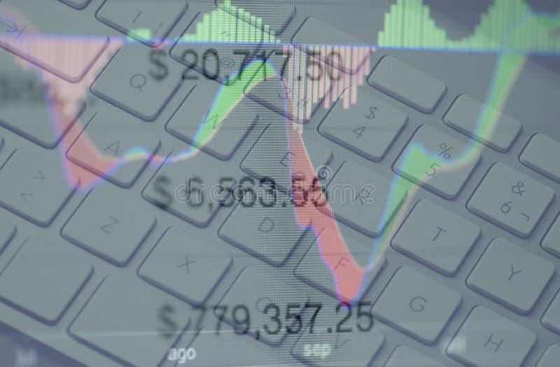 Дело и торгуя концепция с клавиатурой, диаграммами и номерами стоковое фото