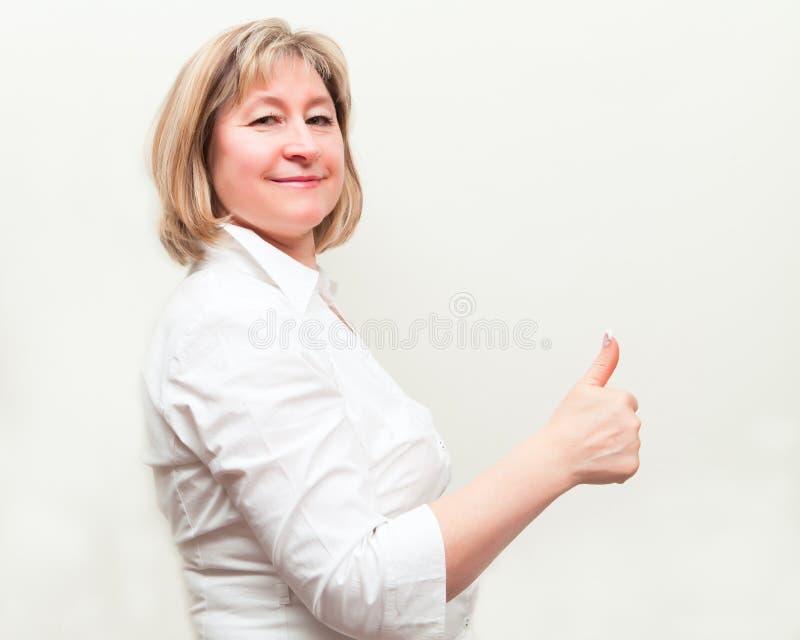 дело счастливый s показывая большой пец руки вверх по женщине стоковые изображения