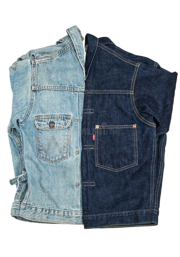 Демикотон моды, изолят куртки джинсовой ткани стоковая фотография