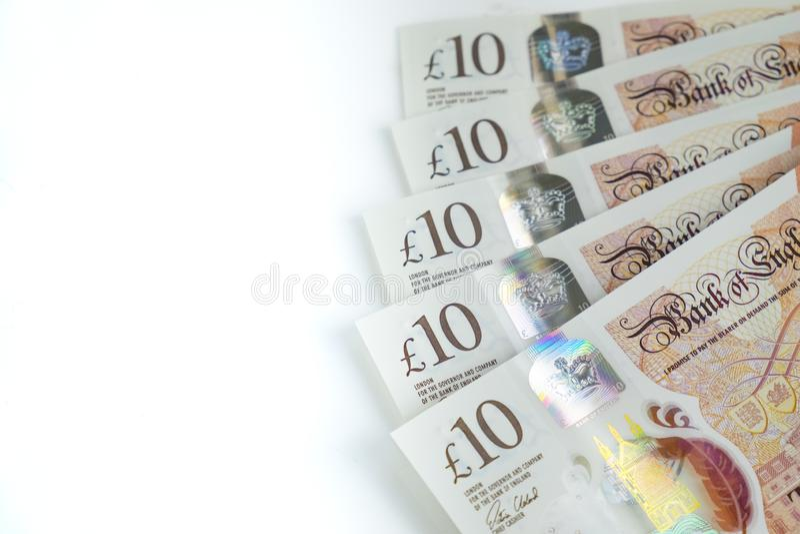 Деньги Великобритании, 10 примечаний фунта известных как десятки стоковое изображение