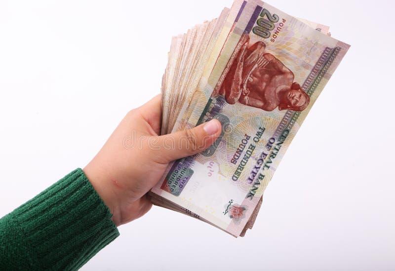 Деньги владением руки египетские бумажные стоковое изображение rf