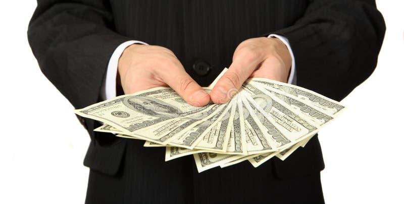 Деньги в руке стоковое фото rf