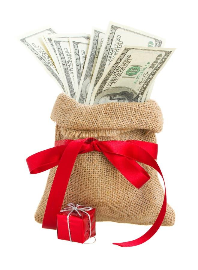 Деньги в сумке подарка стоковые изображения rf