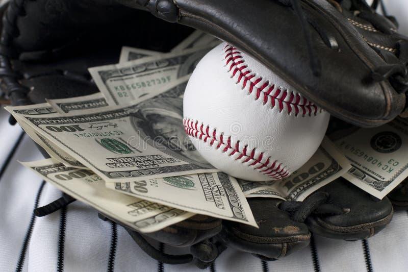 деньги дела бейсбола стоковое фото