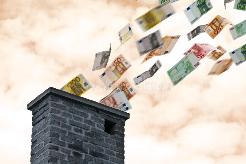 Деньги евро летают вверх по печной трубе стоковая фотография
