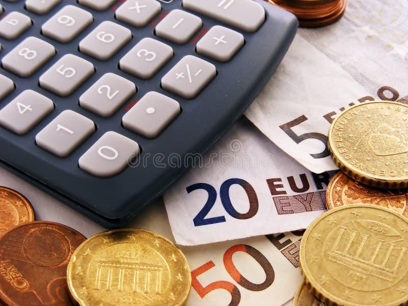 деньги евро чалькулятора стоковые фото