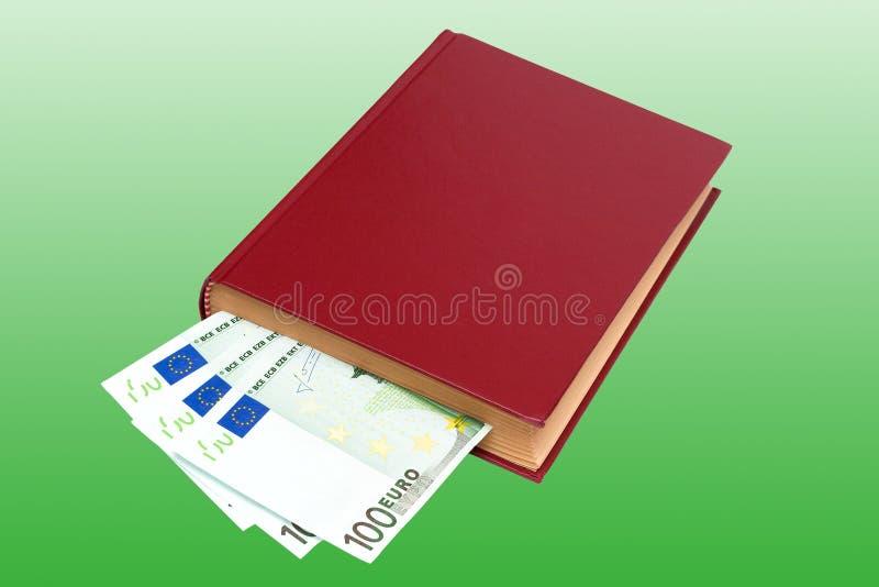 деньги изолированные книгой стоковые фото