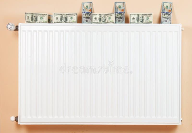 Деньги и топление стоковое фото rf