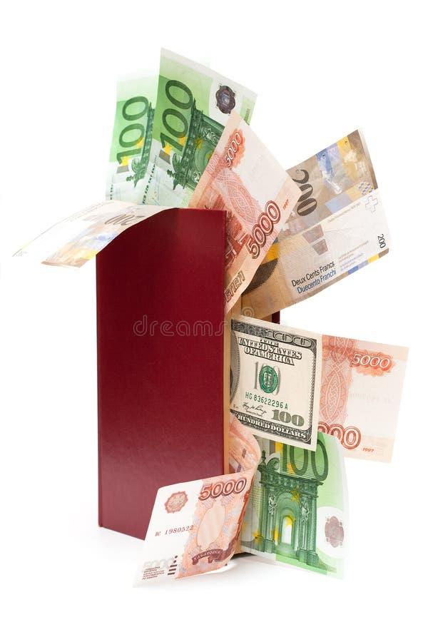 деньги книги стоковые изображения