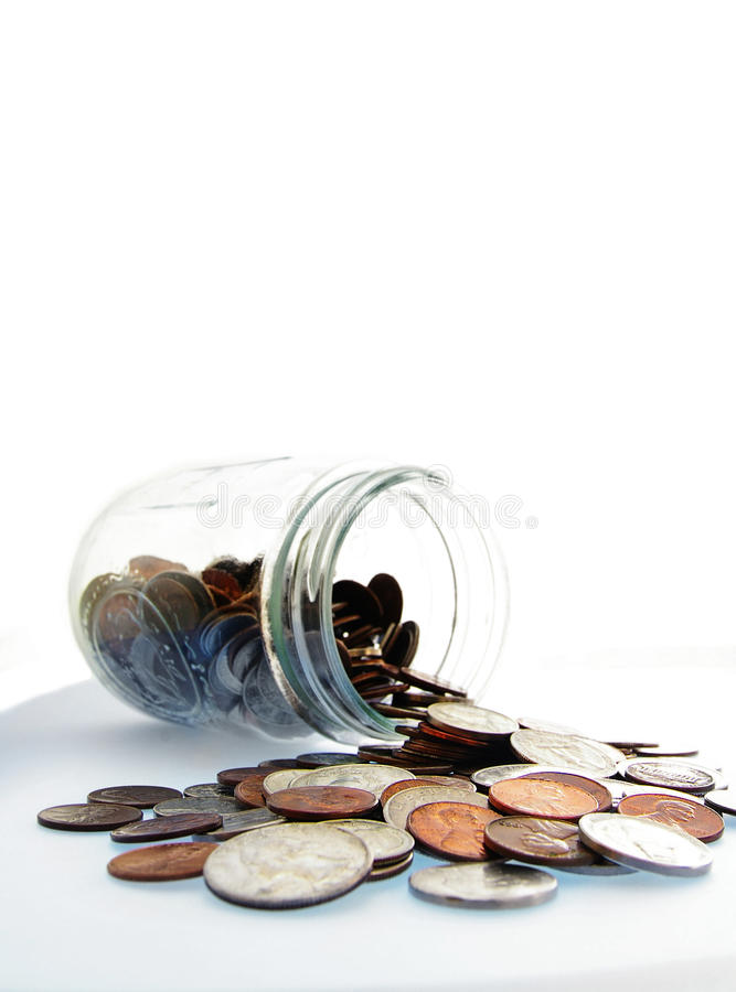 деньги опарника монетки стоковое фото rf