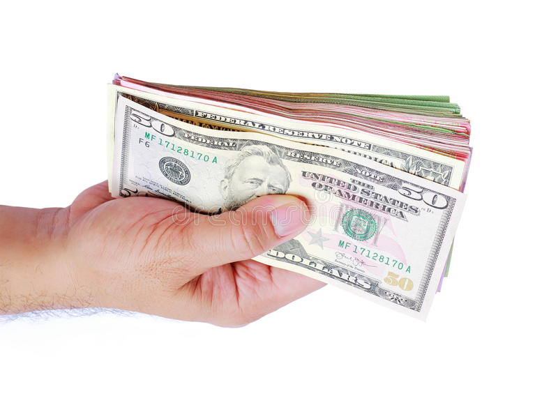 Деньги доллара показывая в руке ` s людей на белой предпосылке стоковые фотографии rf
