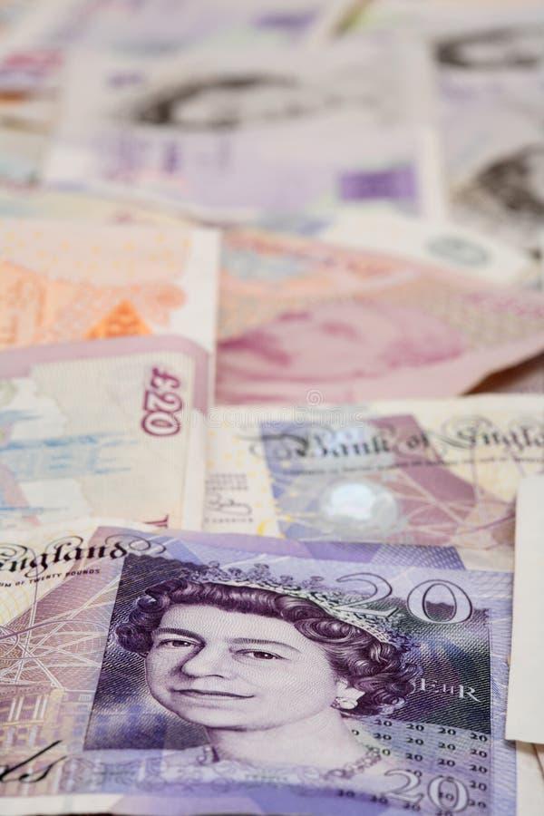 деньги предпосылки английские замечают фунт стоковые фотографии rf