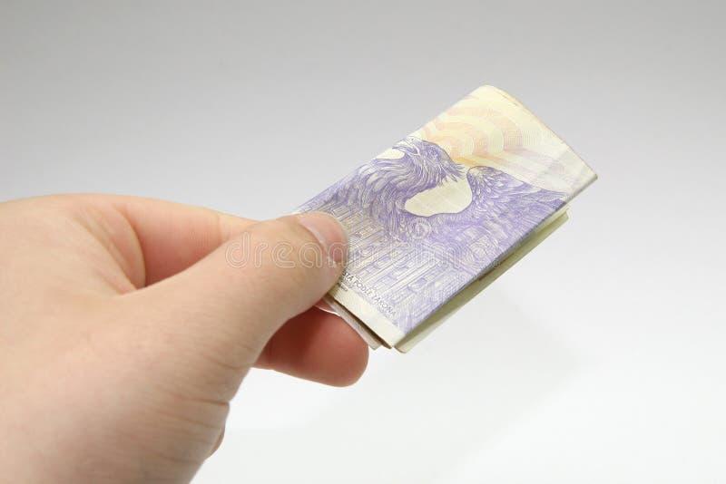 деньги руки тысяча кредиток чехословакские стоковое изображение