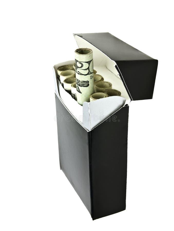 деньги сигарет стоковое фото rf