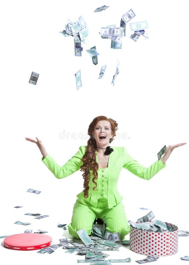 Деньги счастливой женщины бросая стоковые фотографии rf