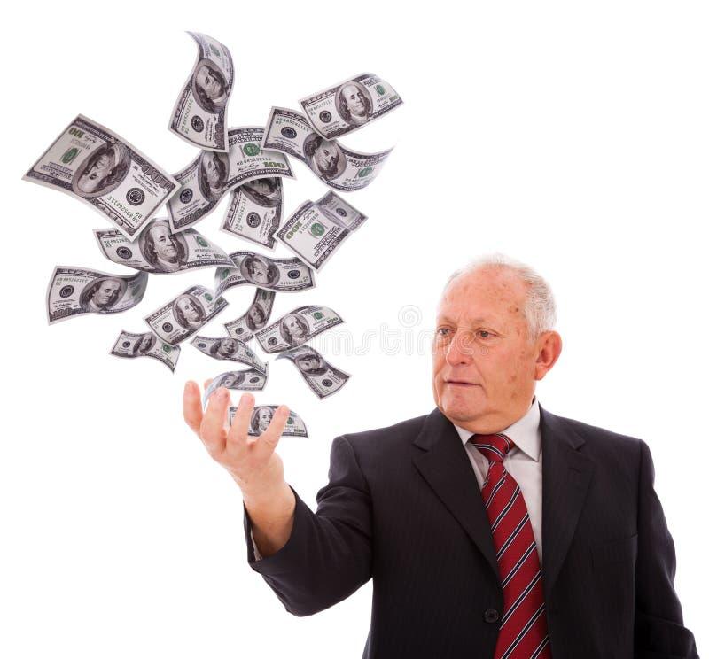 деньги удерживания бизнесмена стоковая фотография