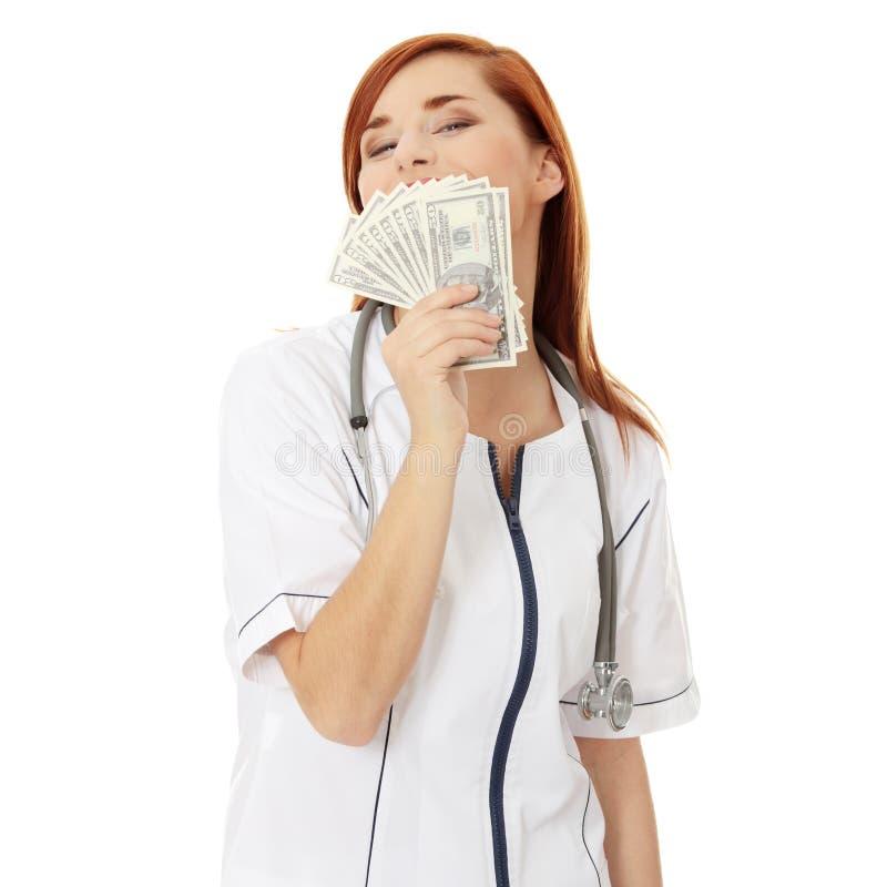 деньги удерживания доктора женские стоковое изображение rf
