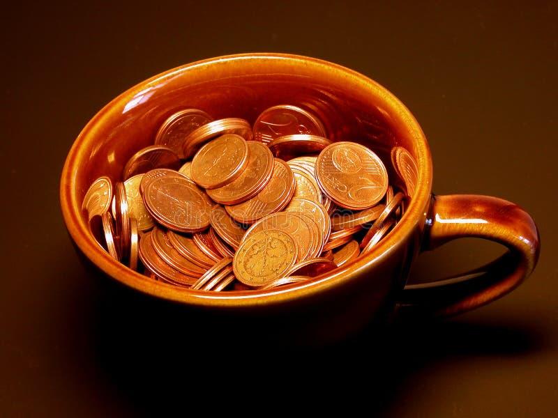 деньги чашки стоковые изображения