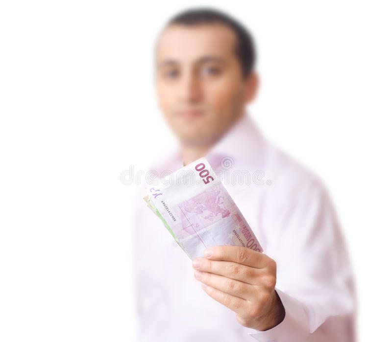 деньги человека показывая детенышей стоковое изображение