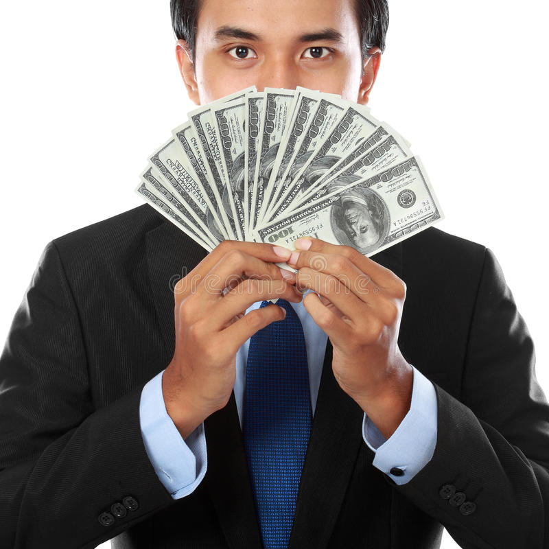 деньги человека удерживания дела стоковые фото